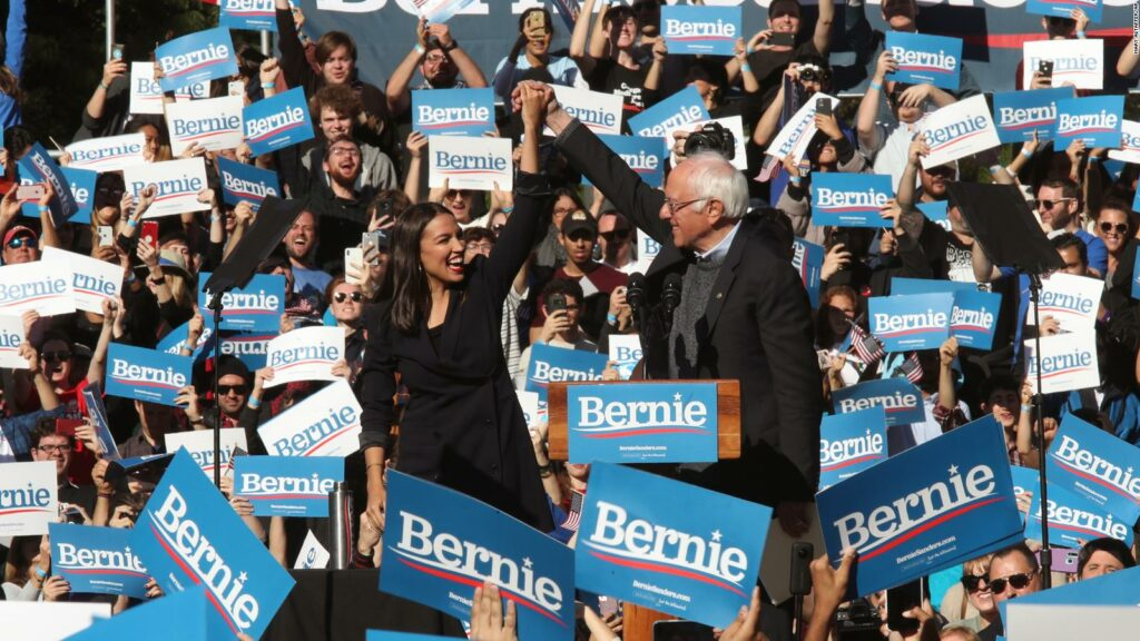 Bernie Sanders and Alexandria Ocasio-Cortez at a rally in New York